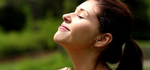 stock-footage-pretty-young-woman-basking-in-the-sun-smiling